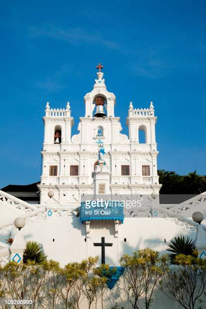 ornate church and bell tower of the church of the immaculate conception - goa stock photos and pictures