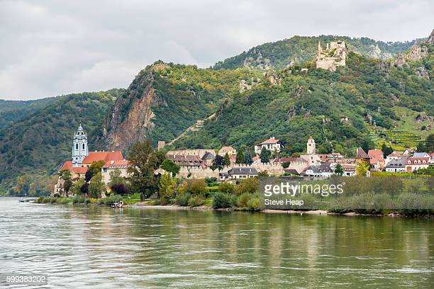Ornate church and buildings on banks of River Danube in Durnstein, Austria