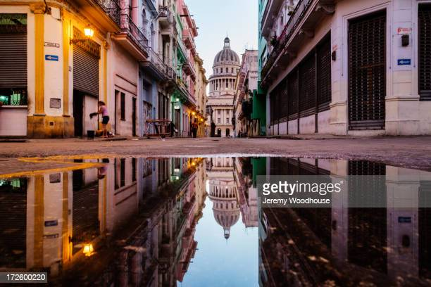 ornate city building reflected in puddle, havana, cuba - キューバ ストックフォトと画像