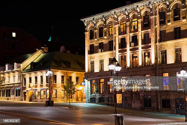 ornate city buildings lit up at night - place jacques cartier stock pictures, royalty-free photos & images