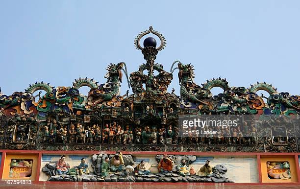 Ornate colourful basrelief of mandarins on the facade of Thien Hau Pagoda in Saigon
