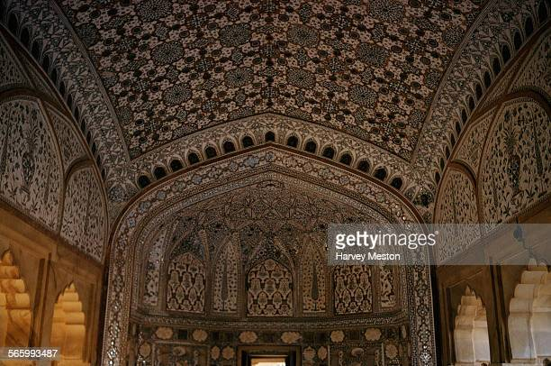 Ornate decorations on the walls and ceilings of the Amer Palace in Jaipur India 1972