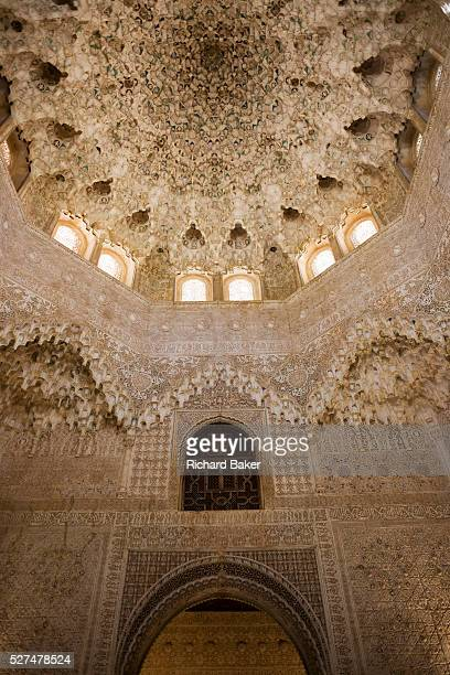 Ornate domed architecture in the Sala de dos Hermanas in Alhambra Palace The hall was built by order of Mohammed V It is square has interlacing...