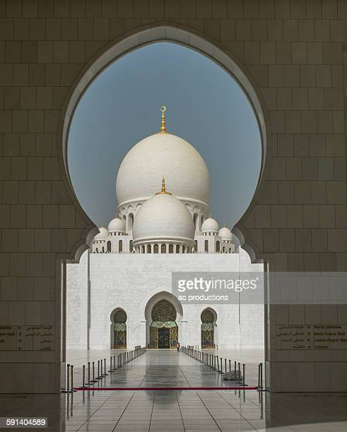 ornate domed building and keyhole archway, abu dhabi, abu dhabi emirate, united arab emirates - arch stock pictures, royalty-free photos & images
