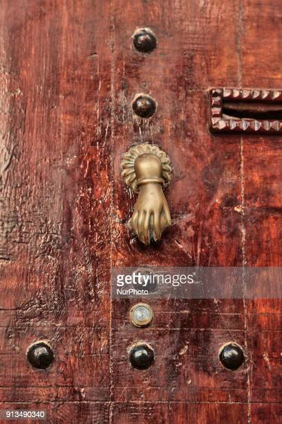 Ornate door knocker shaped like the hand of Fatima on an old door of a home located in the medina of Rabat Morocco Africa