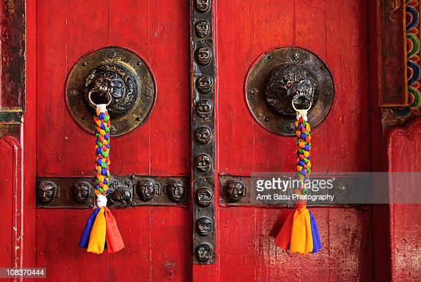 ornate doors at deskit gompa, ladakh, india - amit basu stock pictures, royalty-free photos & images