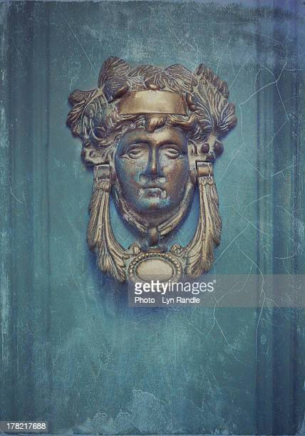 ornate face - door knocker stock photos and pictures