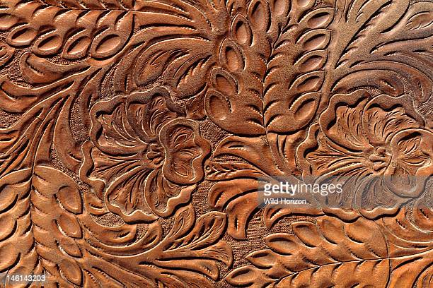 Ornate floral and leaf tooled leather detail on a western saddle Photographed at the Institute of the Range and the American Mustang Wild Horse...