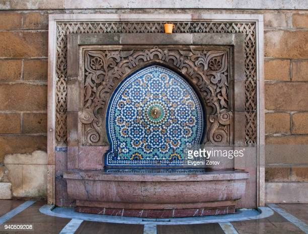 ornate fountain at mausoleum of mohammed v in rabat, morocco - rabat morocco stock pictures, royalty-free photos & images