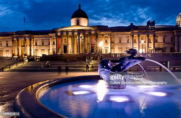 ornate fountain lit up at night - national gallery london stock pictures, royalty-free photos & images