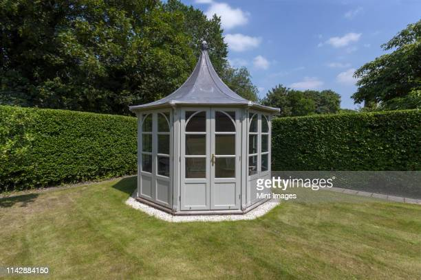 ornate gazebo in backyard - embellishment stock pictures, royalty-free photos & images