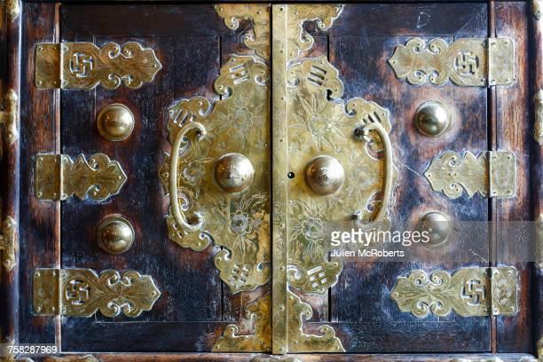 Ornate handles on doors