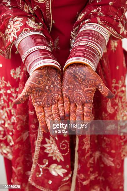 Ornate Indian decoration on Caucasian woman's hands