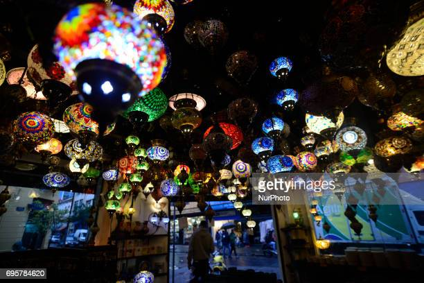 Ornate lamps lanterns inside The march 25 Grand Bazaar São Paulo great market in São Paulo Brazil The Turkish tradition in the glass business is...