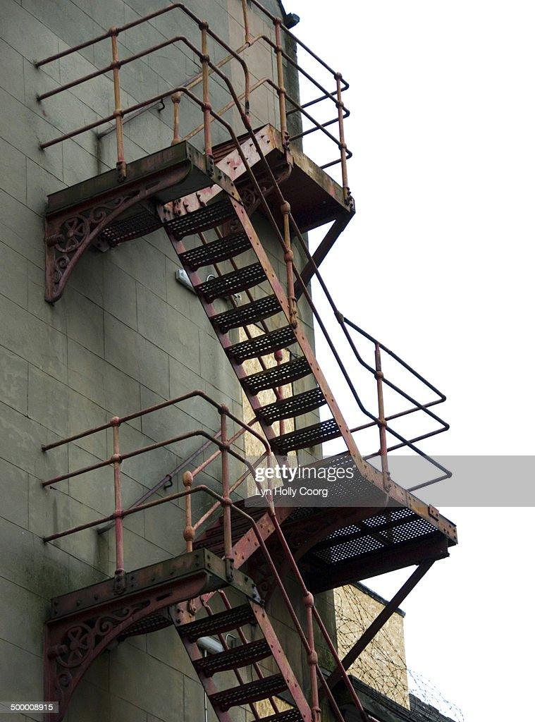 Ornate red fire escape : Stock Photo
