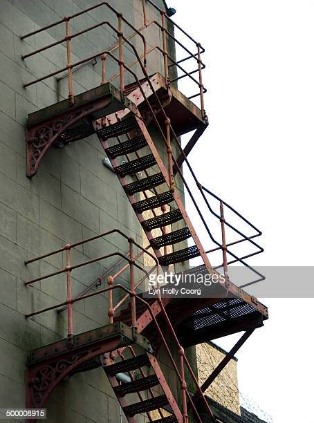 ornate red fire escape - lyn holly coorg stock pictures, royalty-free photos & images