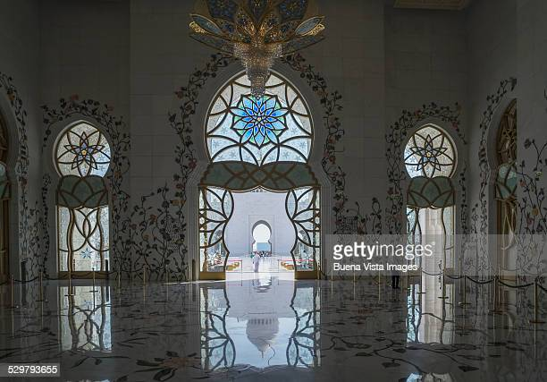ornate stained glass windows and doors in a mosque - moskee stockfoto's en -beelden