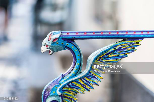 ornate stair railing shaped like a griffin, phoenix or another mythical bird. - phoenix bird stock pictures, royalty-free photos & images