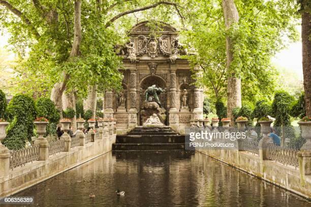 Ornate statue over park stream