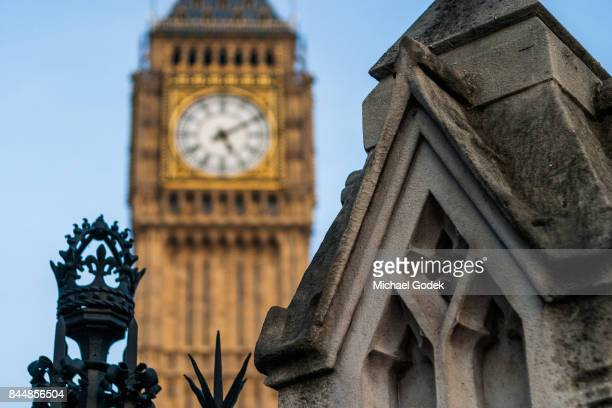 Ornate stone pillar with Big Ben blurred in the background