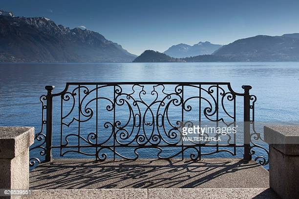 Ornate sunlit iron gate, Lake Como, Italy