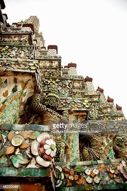 Ornate temple roof with statues, Bangkok, Thailand