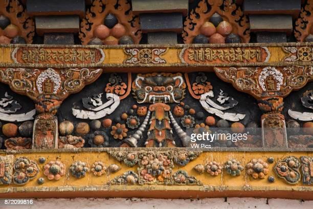 Ornate wood carved architectural detail at the Punakha Dzong. Punakha, Bhutan.