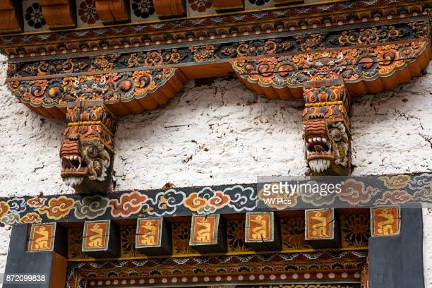 Ornate wood carved architectural detail at the Punakha Dzong Punakha Bhutan