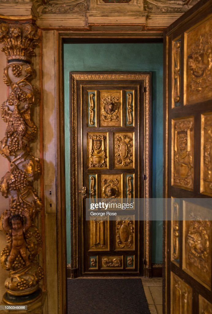 Ornate Wooden Doors Are Viewed In One Of The Upstairs Rooms On
