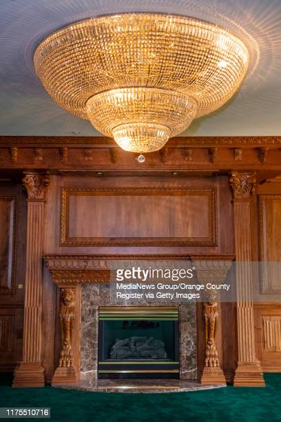 Ornate woodwork and a chandelier in one of the many interior rooms in the former Trinity Broadcasting Network building located on Bear Street and the...