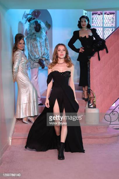 Ornella Muti Ulyana Sergeenko and Dita von Teese walk the runway during the Ulyana Sergeenko Haute Couture Spring/Summer 2020 show as part of Paris...