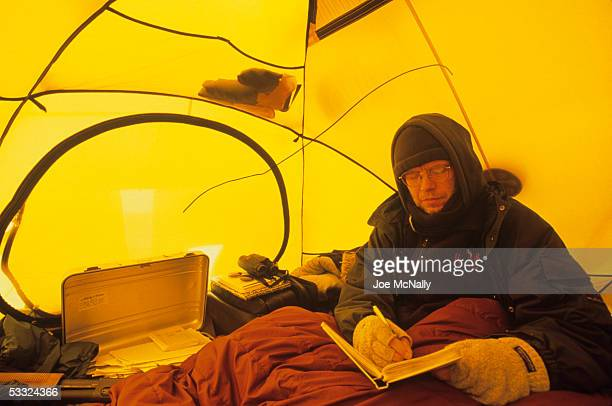 Ornithologist George Divoky studies in his tent August 2001 Cooper Island Alaska Ornithologist George Divoky has journeyed to Cooper Island off the...