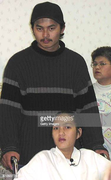 Ornsee Khamsa And Verek Muy Parents Of Identical Quadruplet Girls Are Shown In This Undated Photo In Sacramento Ca The Babie Were Born March 25 2002...
