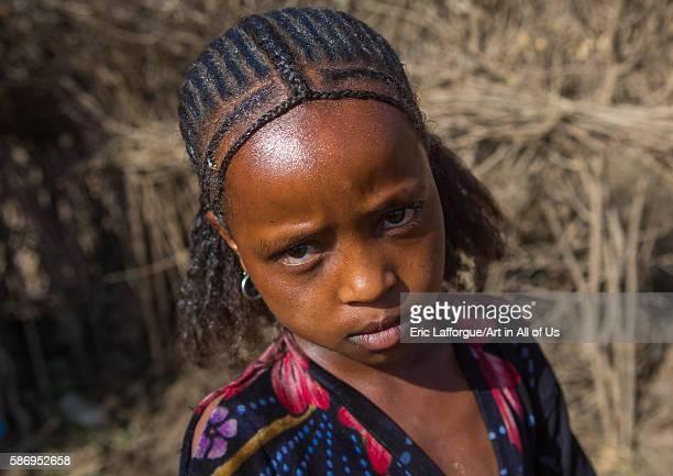 Oromo girl with a nice hairstyle amhara region artuma Ethiopia on February 21 2016 in Artuma Ethiopia