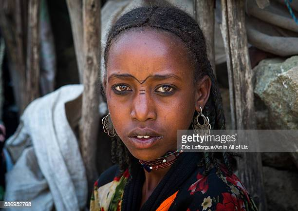 Oromo girl with facial tattoos and silver earrings oromo sambate Ethiopia on February 21 2016 in Sambate Ethiopia