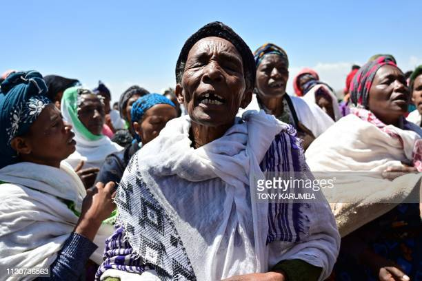 Oromo women perform a traditional chant at the crash site of the Ethiopian Airlines operated Boeing 737 MAX aircraft which killed 157 passengers and...