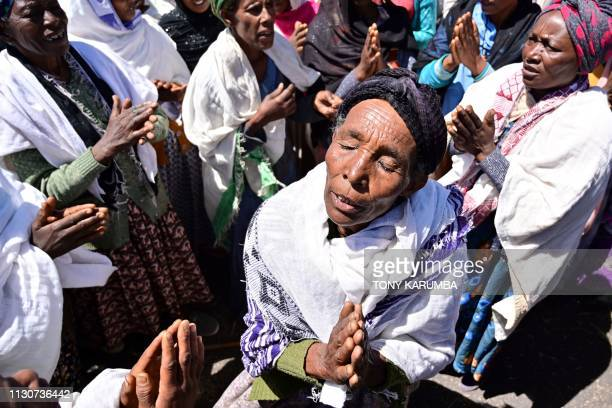 Oromo women perform a traditional chant on March 15 at the crash site of the Ethiopian Airlines operated Boeing 737 MAX aircraft which killed 157...
