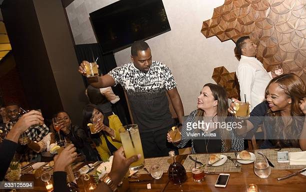 Oronde Garrett and Miss Diddy cheers to Angie Martinez at D'USSE Dinner Series With Angie Martinez My Voice at BOA Steakhouse on May 19 2016 in West...