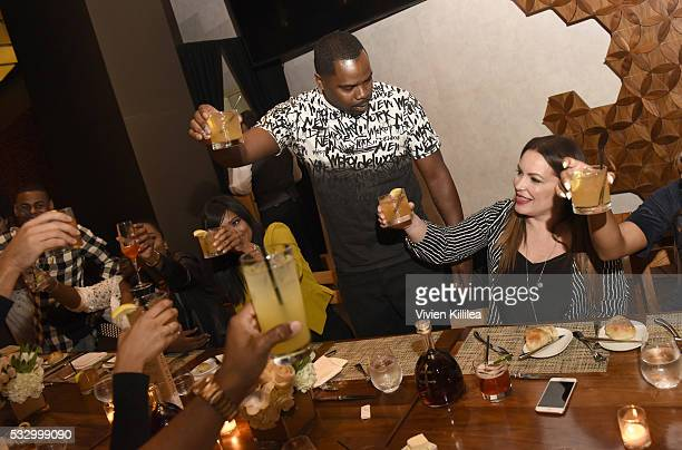 Oronde Garrett makes a toast to Angie Martinez at D'USSE Dinner Series With Angie Martinez My Voice at BOA Steakhouse on May 19 2016 in West...