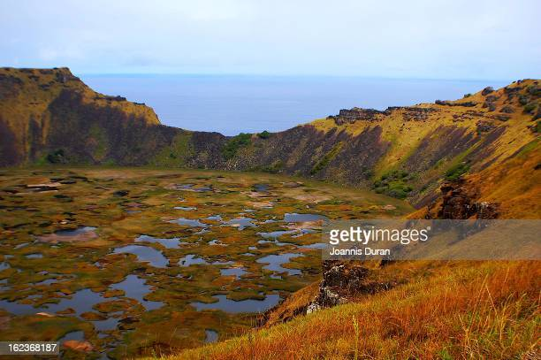 Orongo enjoys a dramatic location on the crater lip of Rano Kau at the point where a 250 meter sea cliff converges with the inner wall of the crater...