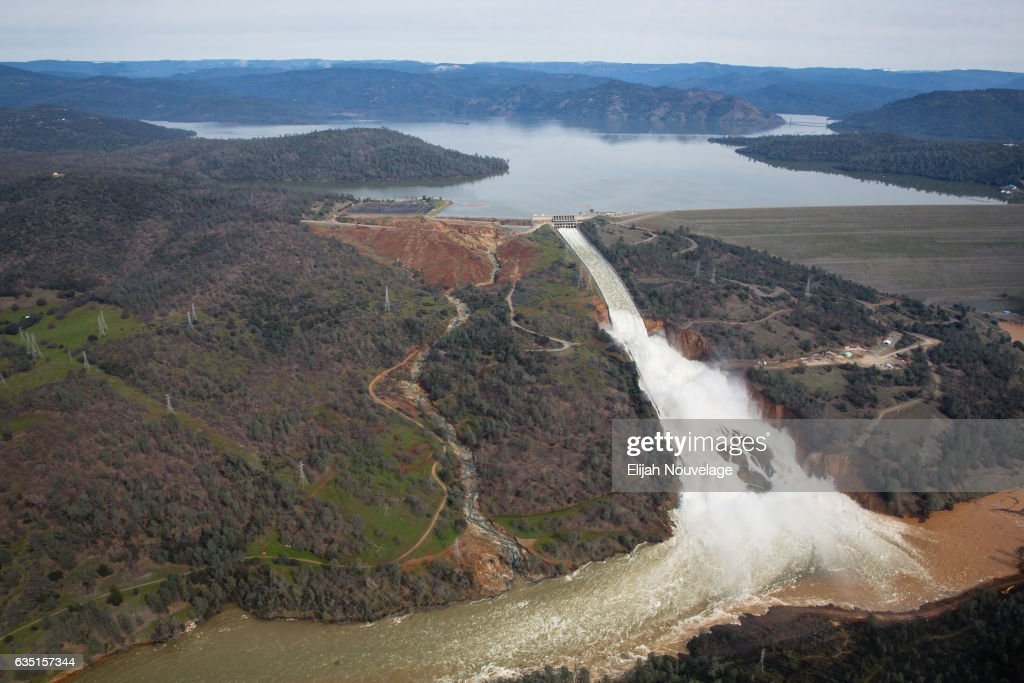 Oroville lake, the emergency spillway, and the damaged main spillway, are seen from the air on February 13, 2017 in Oroville, California. The erosion damage seen below the emergency spillway caused officials to issue evacuation orders yesterday to over 188,000 people in downstream areas.