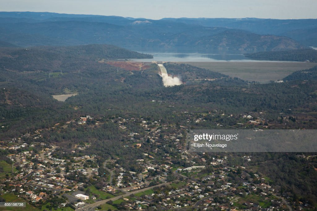 Oroville lake, the emergency spillway, the damaged main spillway, and the earthen Oroville Dam are seen behind the town of Oroville from the air on February 13, 2017 in Oroville, California. Almost 200,000 people were ordered to evacuate the northern California town after a hole in the emergency spillway in the Oroville Dam threatened to flood the surrounding area.