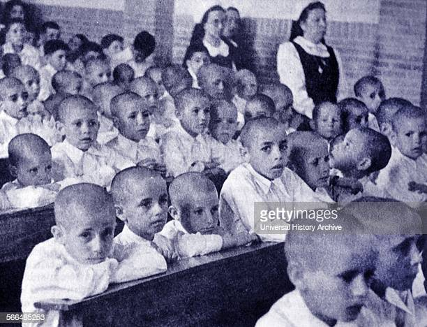 Orphan and refugee children at an auxillo Social centre during the Spanish Civil War A humanitarian relief organization formed during the Spanish...