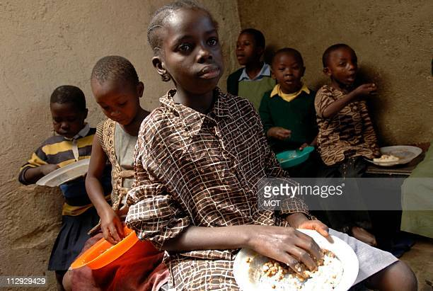 Orphan and vulnerable children attend the feeding program at KENWA's dropin center in Kiambiu a slum area in Nairobi New HIV cases are declining...