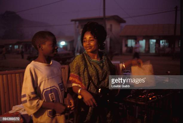Orphaned at age twelve Mercy Bih and her son cook food at her restaurant in the market town of Wum eighteen miles from Lake Nyos