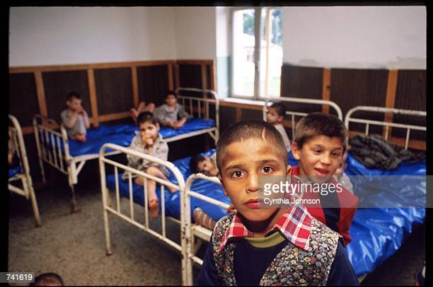 Orphaned children lie in their beds in an orphanage May 15 1990 in Ploiesti Romania Nicolae Ceausescu required women to bear at least five children...
