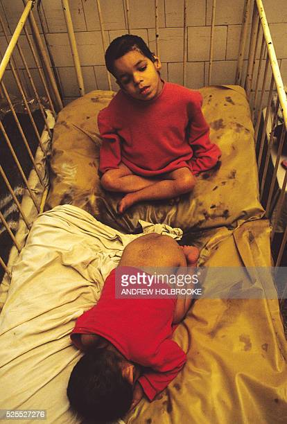 Orphans at the Riul Vadului Mental Asylum sharing filthy fecesstained cribs | Location Altania Romania