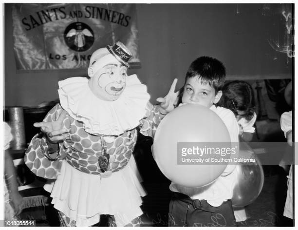 Orphans party 10 August 1951 Bozo the Clown directs kids in balloon blowing contest