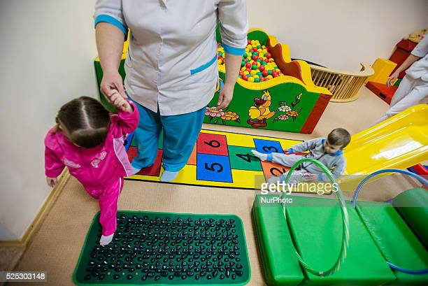 Orphans play in physiotherapy room Orphanage 'Zhytomyr regional children home' Ukraine 2 February 2015 'Zhytomyr regional children's home' has 67...