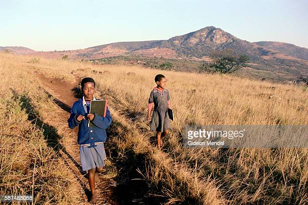 AIDS orphans Pumelele Ndlangamandla and her sister Nosipho Ndlangamandla walk to school in Bhanganoma in rural Swaziland They are looked after by...